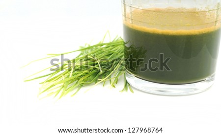 juicing with wheatgrass - stock photo