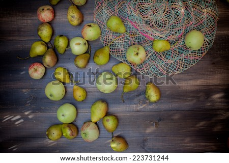 Juicy apples and pears on wooden table - stock photo