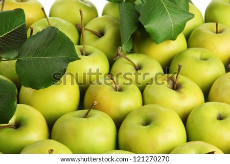 juicy apples with green leaves, close up