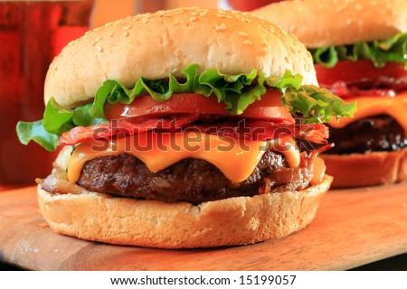 Juicy bacon cheeseburgers. - stock photo