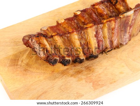 juicy barbecued pork ribs on cutting board