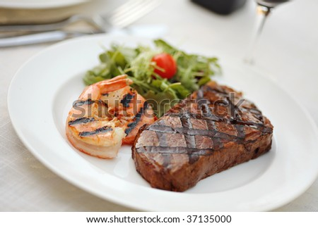 Juicy BBQ sirloin steak with grilled shrimps - Surf and Turf - stock photo
