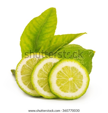 Juicy, beautiful lime with leaves isolated on white background - stock photo
