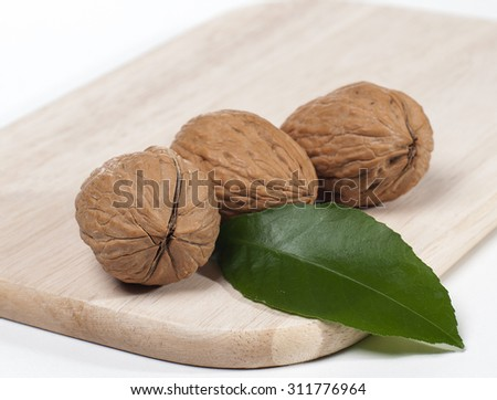 Juicy beautiful walnut closeup on the table - stock photo