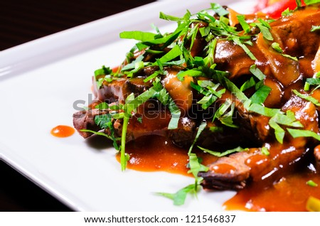 Juicy beef food Juicy beef food with mushrooms over a white plate garnished with parsley
