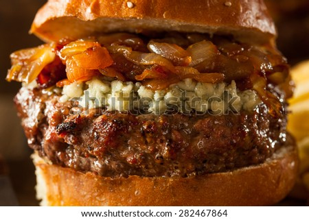 Juicy Blue Cheese Hamburger with Onions and Bacon - stock photo