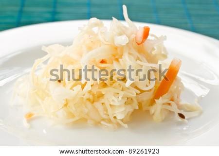 juicy cabbage sauerkraut on the plate - stock photo