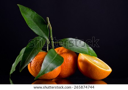 juicy citrus on a black background - stock photo