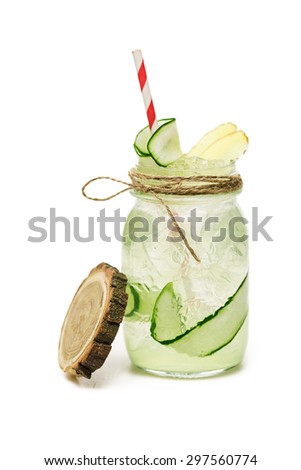 juicy cocktail with cucumber at jar on white background - stock photo