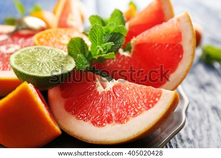Juicy composition of tropical fruits in a bowl, close up - stock photo