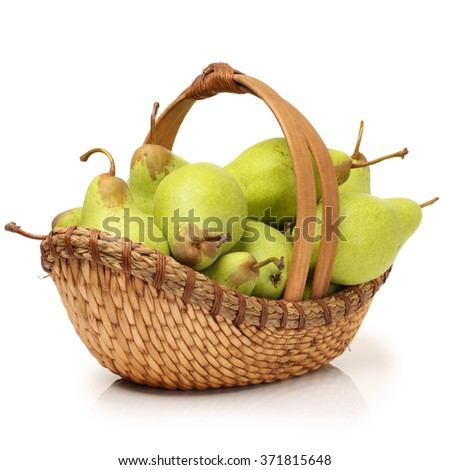Juicy flavorful pears in basket isolated on white - stock photo