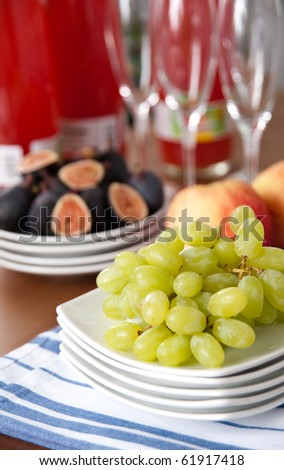 Juicy Fresh Green Grapes on Stack of White Plates