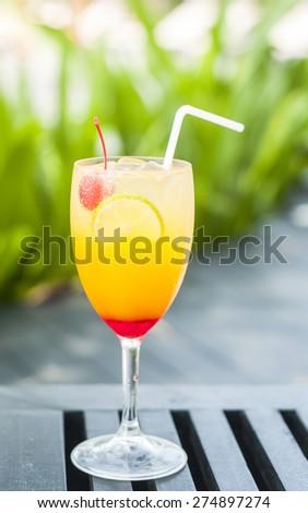Juicy fruits punch in summer green garden background - stock photo