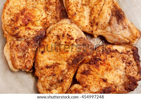 Juicy golden pork steaks 4 pieces, fried in butter with spices, fill the entire frame