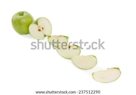 Juicy green apples on the white background