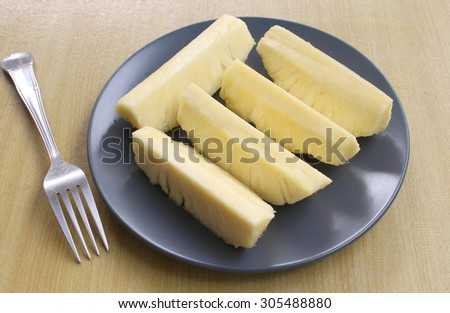Juicy grilled pineapple on plate on table close-up - stock photo
