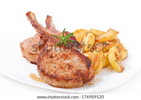 Juicy grilled pork fillet steak with fried apple slices - stock photo