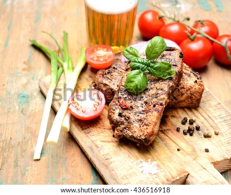 juicy grilled steak, basil,beer and tomatoes - stock photo