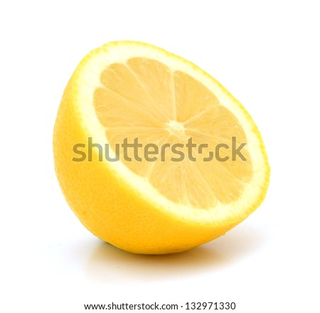 Juicy half of a lemon on a white background - stock photo