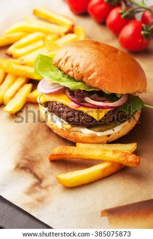 juicy home made burger served with crispy fries.