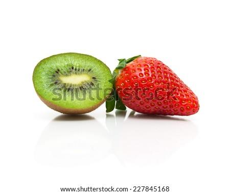 juicy kiwi and strawberries on a white background close-up. horizontal photo. - stock photo