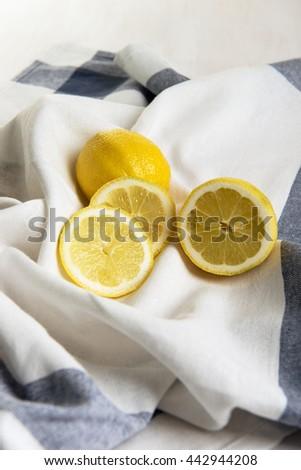Juicy lemon and lemon slices - stock photo