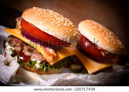 Juicy mini cheeseburgers with bacon and vegetables,selective focus  - stock photo