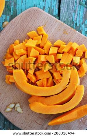 Juicy orange pumpkin on a wooden table - stock photo