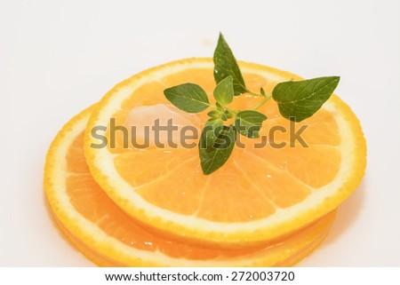 juicy oranges slice with ice and mint - stock photo
