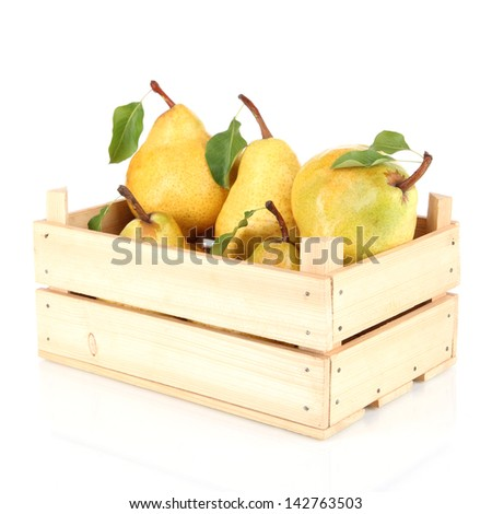 Juicy pears in wooden box isolated on white