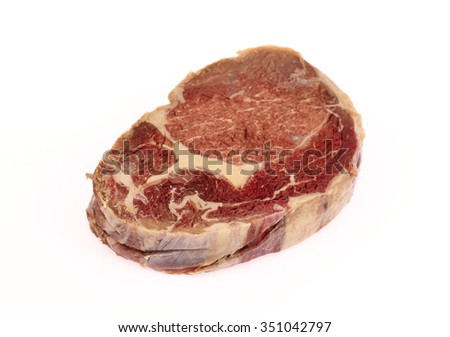 juicy piece of raw beef isolated on a white background