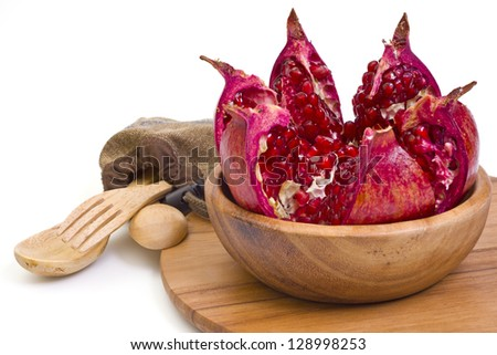 Juicy pomegranate and wooden utensils