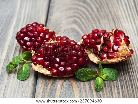 juicy pomegranate on a old wood background