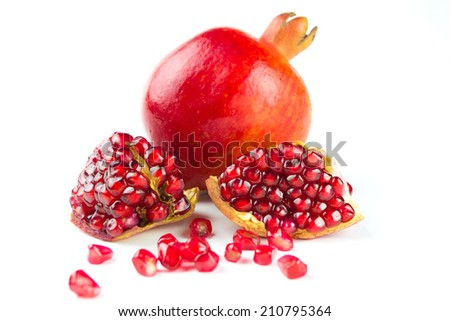 Juicy pomegranates on white background - stock photo