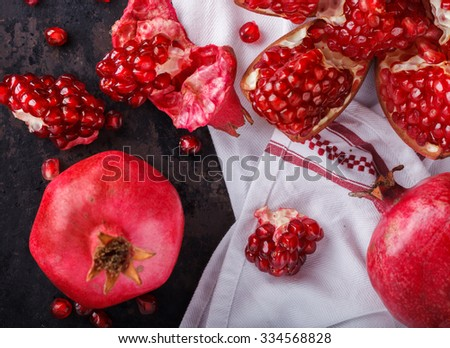 Juicy pomegranates,whole and broken on a dark background.selective focus. - stock photo