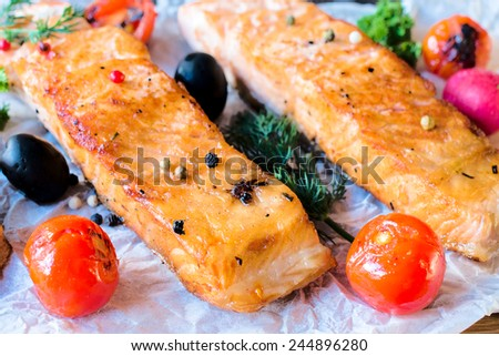 Juicy prepared salmon fillets and grilled tomato,selective focus  - stock photo