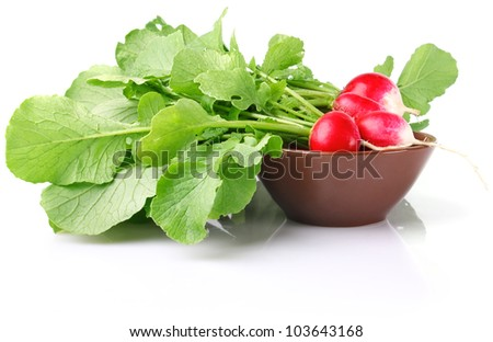 juicy radish with green leaves in ceramic plate isolated on white background - stock photo