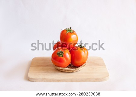 Juicy red tomatoes on a white background. - stock photo