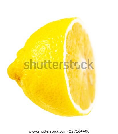 juicy ripe lemon half on white isolated background - stock photo