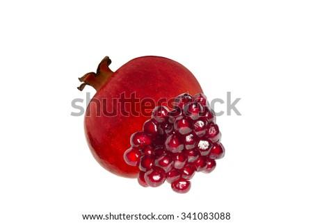 Juicy ripe pomegranate fruit isolated on white background. - stock photo