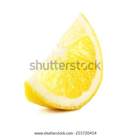 Juicy slice of lemon isolated on white - stock photo