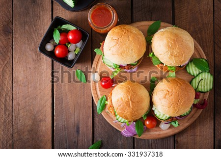 Juicy spicy chicken burgers to Asian-style - sandwich.  Top view - stock photo