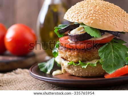 Juicy spicy chicken burgers with tomato and eggplant - sandwich. - stock photo