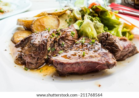 juicy steak beef meat and potatoes