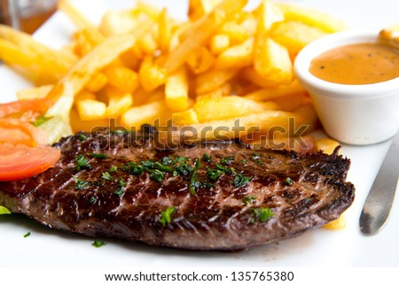 juicy steak beef meat with tomato and potatoes - stock photo