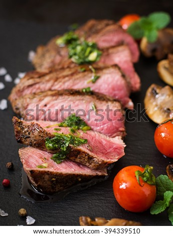 Juicy steak medium rare beef with spices and grilled vegetables.  - stock photo