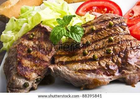 Juicy steak with green pepper