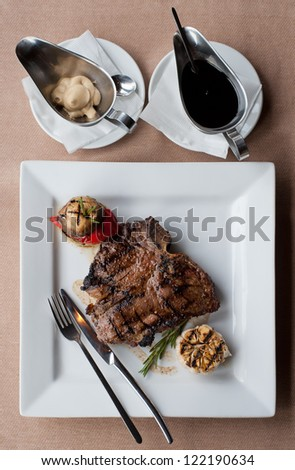 juicy steak with sauces from above - stock photo