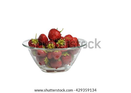 Juicy, tasty strawberry on the glass plate. Strawberries in a glass plate on a wooden table. Isolated white background. Fresh strawberries lay on glass plate.