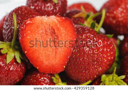 Juicy, tasty strawberry on the glass plate. Strawberries in a glass plate on white background. Close-up fresh strawberries lay on glass plate. Half of strawberry. - stock photo